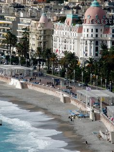 Promenade des Anglais, Nice, France--funny thing is-the dress code for that hotel with the pink dome roof restricted folks but wearing shorts in the lobby of the hotel---but on the beach across the street, you could go topless.  Always found that strange!