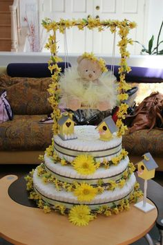 Baby Shower, Bird Cage yellow and gray, Ballerina tutu theme diaper cake. Created by Cyd Haltom Baby Shower Favors, Baby Shower Parties, Baby Shower Decorations, Baby Shower Gifts, Baby Gifts, Pamper Cake, Baby Shower Announcement, Diaper Parties, Sunflower Baby Showers