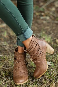 "Pretty, petite, soft, and sympathetic, people often underestimate your strength, but you'll show them you're Strong Enough with these steady Brown Ankle Boots that showcase your tenacity. Your inner strength is stronger than any muscles could support! These booties feature a criss cross upper with a zipper at the heel cup and a stacked heel.  • Heel measures 3.25"" • Vegan friendly, man made materials • Imported"