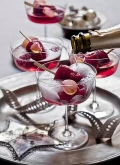 Champagne served over a raspberry popsicle with a  couple of frozen raspberries, - a delicious & fun way to serve the bubbly