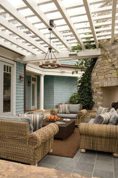 Thanks to outdoor wicker furniture that looks like it could reside indoors, this patio gives off a relaxed, but traditional vibe. The oversized chairs and muted color palette help create a quiet elegance in the backyard.   - GoodHousekeeping.com