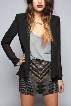 Blazer, art deco inspired skirt, tank top, dark lips.
