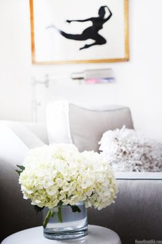 """Hydrangeas sit on a side table beside a chair Fuge found """"super on sale at a shop in Maryland."""