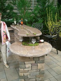 Concrete countertop outdoor kitchen with water feature