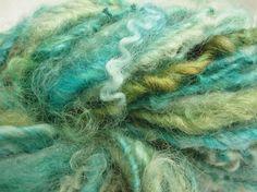twirly curls of waves of sea greens