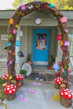 "Down the Rabbit Hole and into Wonderland... This was the entrance to my daughter's Alice in Wonderland themed party. I re-purposed an old wedding arch and covered it in brown fabric, colorful flowers, and butterflies to create the rabbit hole. Tree stumps from our backyard topped with ""mushroom caps"" created larger than life toadstools. You can even see the white rabbit left his footprints behind...Oh Mr. Rabbit!!!"