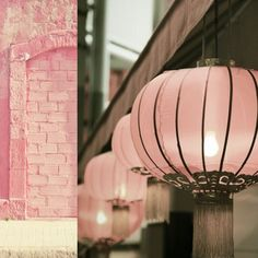 pink decor + bricks and lampshades