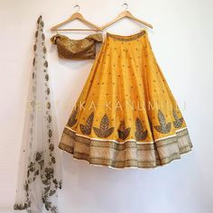 Shop silk mustard Party wear lehenga choli with scintillating lace & embroidery work.This set is features a mustard blouse in silk fully embellished with crystal, embroidery and sequin work.It has matching mustard lehenga in silk with beautiful embroi Indian Attire, Indian Ethnic Wear, Indian Style, Sabyasachi, Lehenga Choli, Bridal Lehenga, Choli Dress, Bollywood Lehenga, Lehenga Skirt
