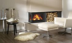 Modern black electric fireplace design ideas come with modern white leather armchair and white fur rug on wooden floor plus cream wall paint : Home Design Inset Fireplace, Wood Burner Fireplace, Fireplace Inserts, Modern Fireplace, Fireplace Wall, Wall Fireplaces, Corner Fireplaces, Traditional Fireplace, Inset Log Burners