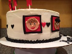 One Direction themed birthday cake. Little portraits are made of fondant.