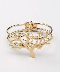 Bring the beauty of nature right to the wrist. Delicate boughs and branches in shimmering gold plate lend this cuff some organic-style luxury. W x circumferenceGold-plated base metalImported Pagan Jewelry, Jewelry Tree, Jewelry Accessories, Fashion Accessories, Earthy Style, Eyes Emoji, Tree Of Life, Gold Rings, Bling