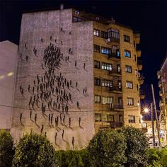Squiggly Figures Congregate on a Building in Spain-Visual artist SUSO33, known for his abstract human forms comprised of quick gestural lines, recently painted this large-scale mural in Madrid depicting a hundred or so of his figures gathering to form a large one.