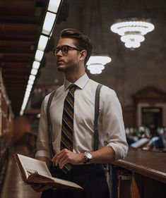 with a business outfit idea with a navy green striped silk tie olive green suspenders glasses navy trousers watch Modern Gentleman, Gentleman Style, Man Street Style, Men With Suspenders, Adam Gallagher, Outfits Hombre, Men Photoshoot, Photography Poses For Men, Man Style