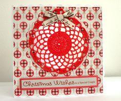 Crochet bauble on festive paper