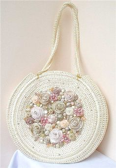 Beautiful crochet purse by master crocheter Svetlana Tregub. Round Crochet Purse with Ribbon flowers & beads. This would be great if it had a pattern attached, but alas it is but a photo… Great combination of crochet and ribbon embroidery. Love Crochet, Beautiful Crochet, Knit Crochet, Crochet Round, Embroidery Bags, Silk Ribbon Embroidery, Crochet Handbags, Crochet Purses, Crochet Bags