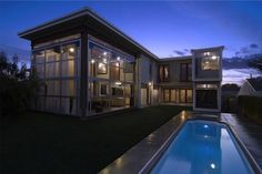 In DeMaria's hybrid design for the Redondo Beach House, conventional stick-frame construction combines with eight repurposed steel shipping containers to form the two-story home.