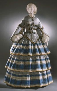 @1858, figured silk- amazing creation! Look at that wonderful trim. Love the use of the fabric to emphasis the small waist.