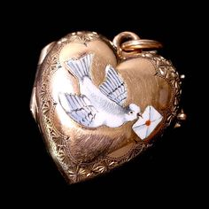 It is only gold plated but is enamelled with a wonderful dove carrying a letter sealed… Locket Charms, Heart Locket, Lockets, Rare Antique, Antique Gold, Gold Locket, Cute Charms, Jewelery, Jewelry Box