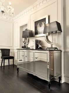 MIRRORED CREDENZA | This exquisite mirrored credenza will add a touch of contemporary elegance and refinement to your home | See more at: www.bocadolobo.com #moderncabinets #luxurysideboard