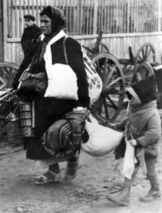 Lodz, Poland, A woman and a child during deportation. They will sadly be murdered by the Nazis.