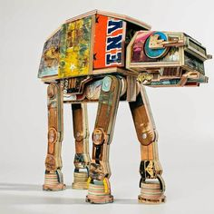 "Star Wars AT-AT Walker made from re purposed skateboard decks ~ ""If you are a fan of Star Wars and also a Skateboarder, you will love this amazing sculpture of an AT-AT walker entirely made from repurposed skateboard decks by Derek Keenan's! It measures 16 inches tall by 17 inches long and features articulated joints. The sculpture could be seen in an exhibition called Deathstar Blues and currently open at The Black Book Gallery in Denver, Colorado."""