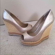 Saks fifth avenue metallic gold wedges 4 inch wedge. Worn once Saks Fifth Avenue Shoes Wedges