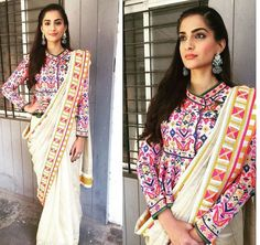 While hosting the flag at Neerja Bhanot's alma mater, Sonam wore an Abhu Jani Sandeep Khosla saree, with a peplum style blouse. The outfit had a burst of colours in it, which made it look rich and coloufrul