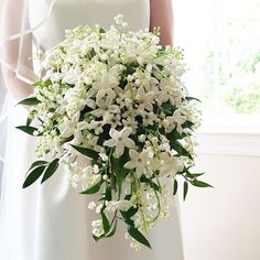Lily of the valley love. This gorgeous bouquet was carried by the beyond beautiful Taylor Ryan Germain yesterday. Congratulations! @teldenryan ! Bouquet: @amaryllisinc iPhone pic: @abbyjiu .