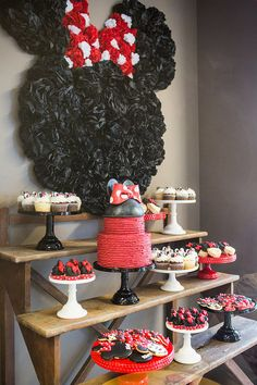 The dessert table was a sight to see! Tissue pom-poms were used to create a huge Minnie Mouse silhouette.