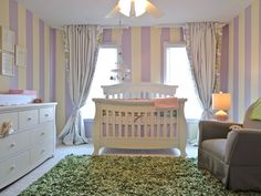 The stripes give this nursery such a warmth and inviting feeling making the Renaissance Convertible Crib the main focus.