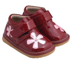 These lovely patent red flower boots feature a velcro side closure for a secure, adjustable fit and stitched flower embellishments for that perfect girly look.