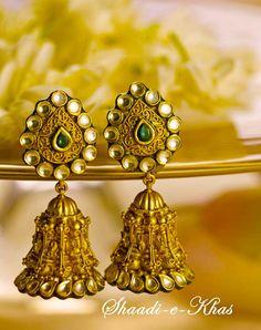 eye catching jhunkaas, with green emaralds.. http://www.shaadiekhas.com/blog-wedding-planning-invitation-wordings/glitter-with-wedding-jitters/