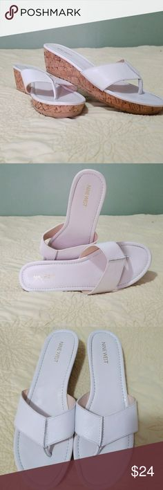 Women's Nine West cork sandals Like new bright white sandals in women's size 11. Worn twice with lots of life left. Fun cork wedge style bottom. I ship fast from a clean smoke free home. Thanks for checking out my closet! Nine West Shoes Sandals