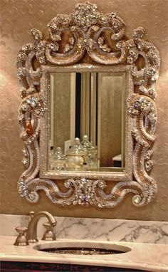 I have this same mirror, it comes with jewels and with out the jewels in a gold/bronze finish. I would only buy it with jewels if using in a bathroom/bedroom.