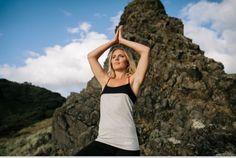Beach yoga while wearing Lhotse organic yoga clothing. Photographed on Karekare bay, New Zealand.