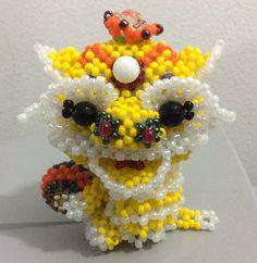 Lion dragon made of Japanese seed bead MGB. 52 gr , 7.5 cm height, 7 cm length, width 4 cm. 30 April 2015