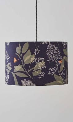 Lorna Syson | Buds and Butterflies Lampshade | Looking for a dark coloured lampshade for your newly decorated bedroom? This one lets in enough light as well as creating a cosy and dreamy room for your interior. Inspired by wildlife, part of the 'Garden' collection.
