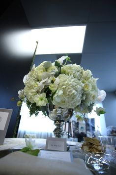 Large white flower arrangement in silver container