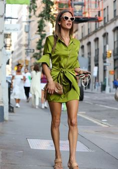 Alessandra Ambrosio in a mini green satin dress and sandals | For more style inspiration visit 40plusstyle.com