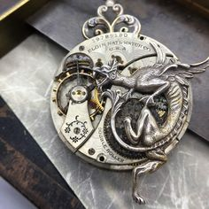 Dragons rule! Elgin pocket watch with dragon necklace