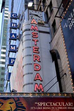 The New Amsterdam Theatre is located on the south side of 42nd Street, between 7th and 8th Avenue. The New Amsterdam Theatre was designed by architects Herts and Tallant in the Art Nouveau style. The essential architecture has been preserved, including the theater's elaborately painted arch and ornate friezes. The lobbies have been decorated with intricate carvings and Shakespearean wall reliefs.