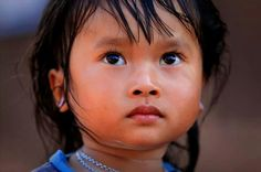 Phu Noy Child, Ban Dong village, Laos by Claude Gourlay