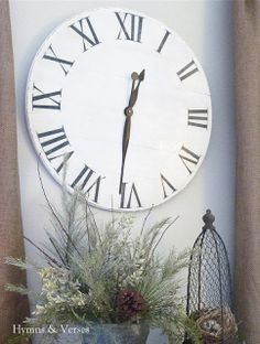 Do you have an old round (or square) table that's seen better days?  Make the top into a wall clock!