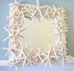 White Finger Starfish Mirror. Would make a good craft project. Paint a wooden frame white and glue on starfish overlapping and layering.