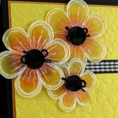 handmade vellum flowers ...close-up of vellum flowers from a bright yellow card ... embossed in white ... flipped over and colored with Spectrum Noir pens ... buttons with string for flower centers ...