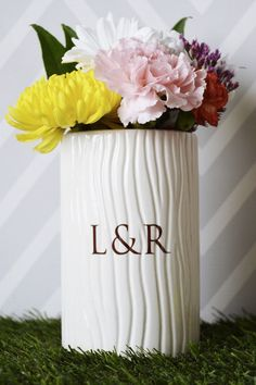 This ceramic rustic yet modern vase would be a great engagement,  wedding or anniversary gift or you could use them as a wedding  centerpiece. This beautiful vase has a unique wood grain detail on the  outside which makes it so special and unique.  #weddingdecor #weddingdecoration #engagementgift #bridalshowergift  #vase #personalizedvase #ceramicvase #weddingvase #anniversaryvase #weddinggift #weddingcenterpeice #anniversarygift