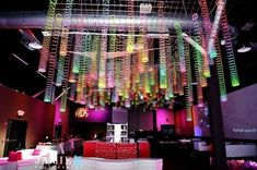 Slinky chandeliers hung from the ceiling - great for an 80's themed party!
