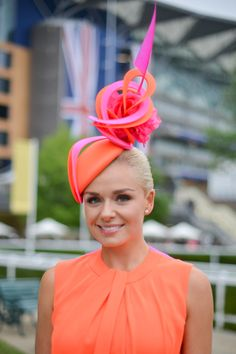 Orange dress black fascinator uk