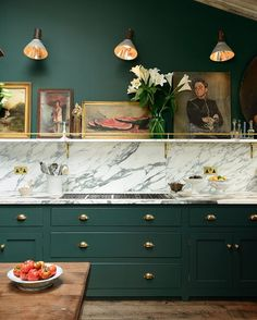marble slab + open shelf ledge + sconces + emerald green