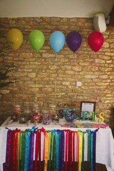 I generally don't like balloons but think these are really cute above the sweets table